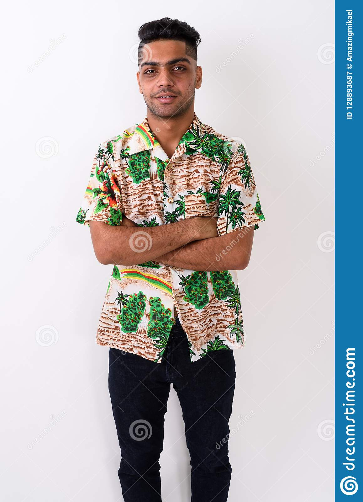 b4739d137 Studio shot of young Indian tourist man wearing Hawaiian shirt against  white background