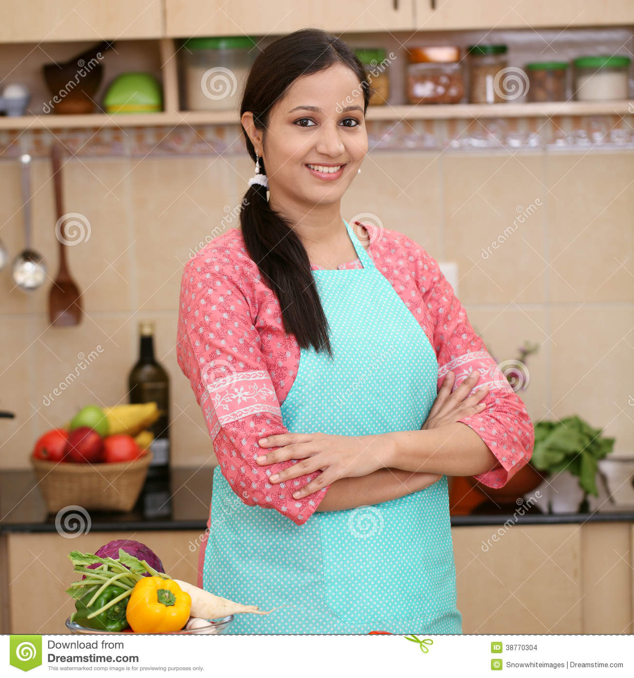 Women Kitchen: Young Indian Woman With Kitchen Apron Stock Images