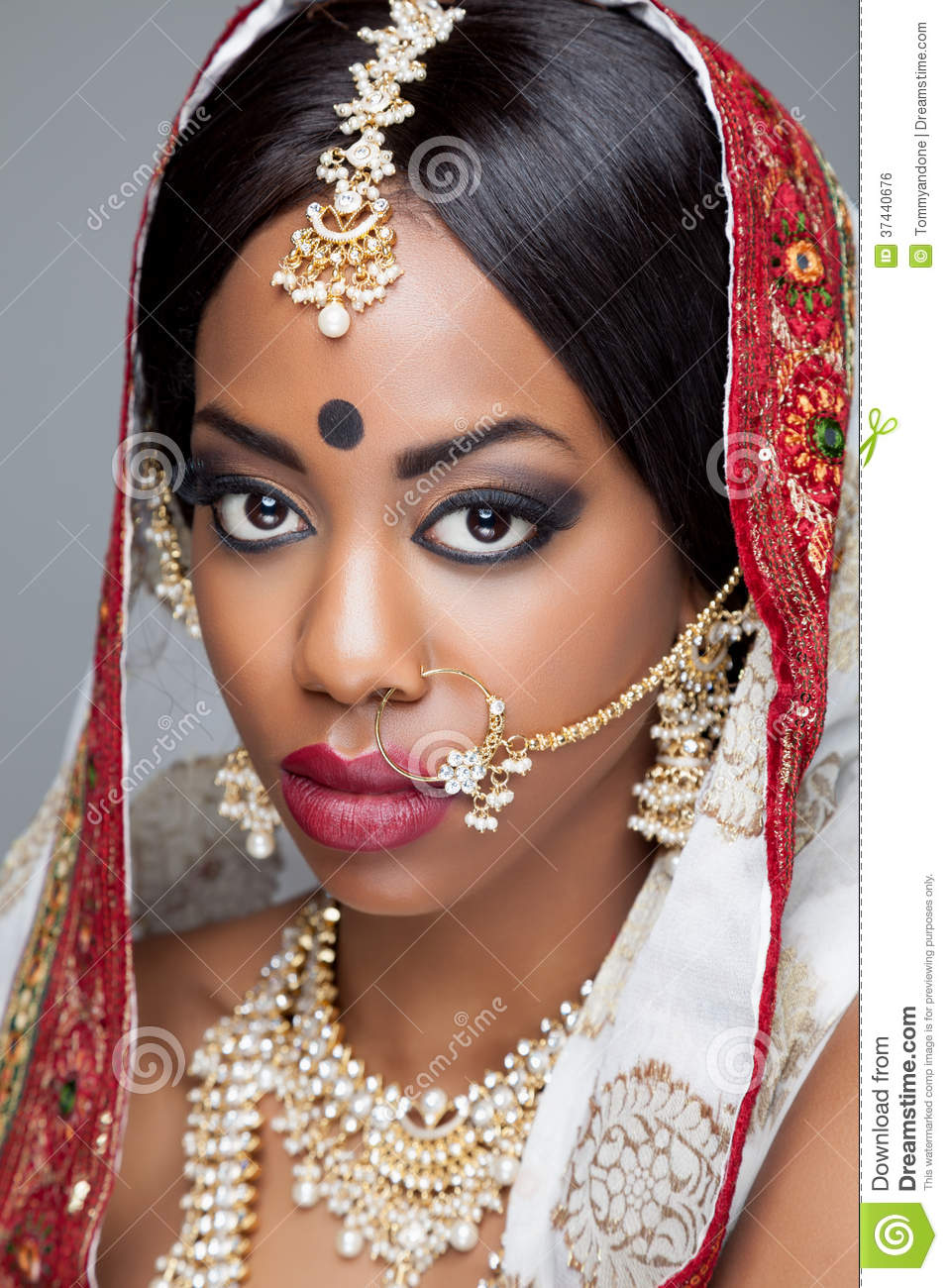 young indian woman in traditional clothing with bridal