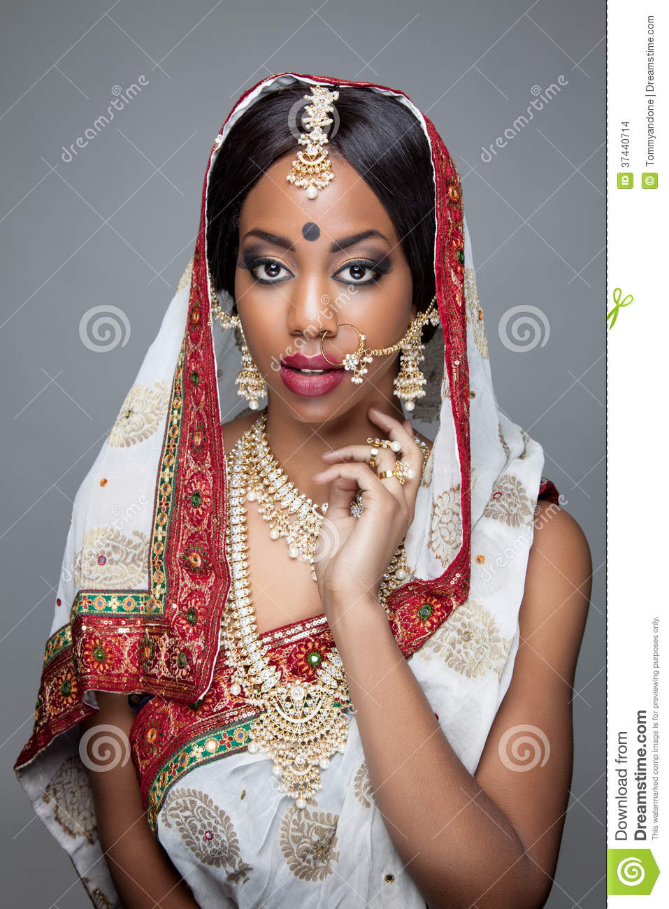 Young Indian woman dressed in traditional clothing with bridal makeup