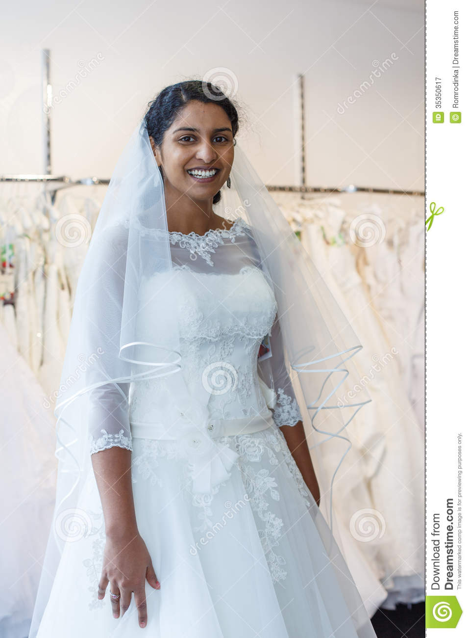 Young indian woman in wedding dress with bridal gowns on for Indian women wedding dress