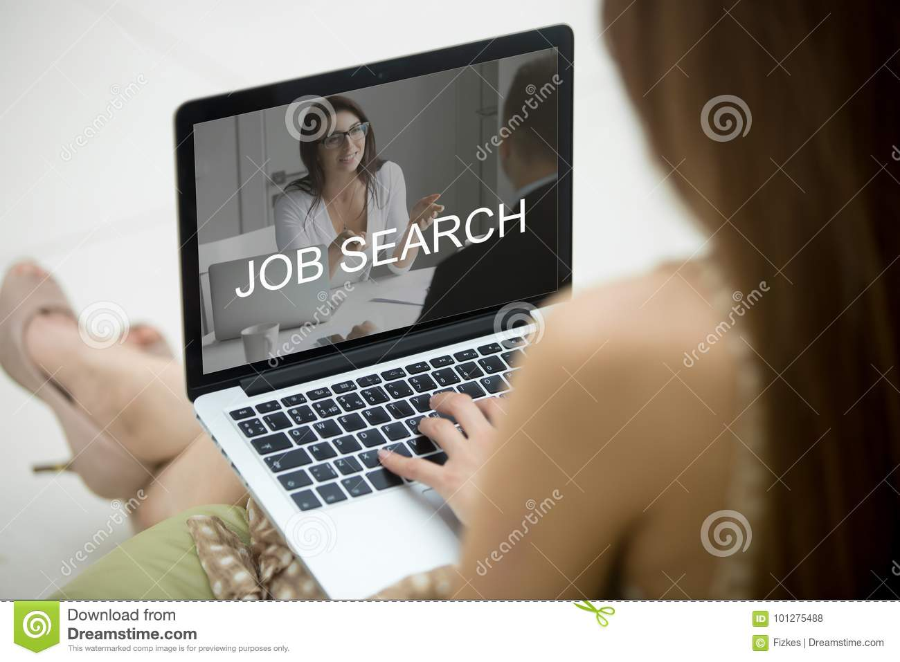 Woman sitting on sofa with laptop, trying to find job.