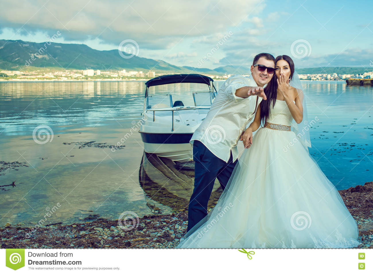 Young Just Married Couple Standing Near The Boat At The Seaside In ...