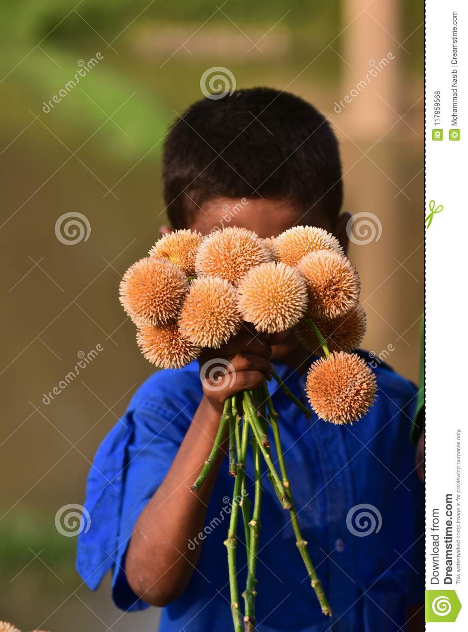 Download Young Kid Is Selling Flowers On The Street Isolated Unique Photograph Editorial Stock Photo - Image of child, natural: 117959568
