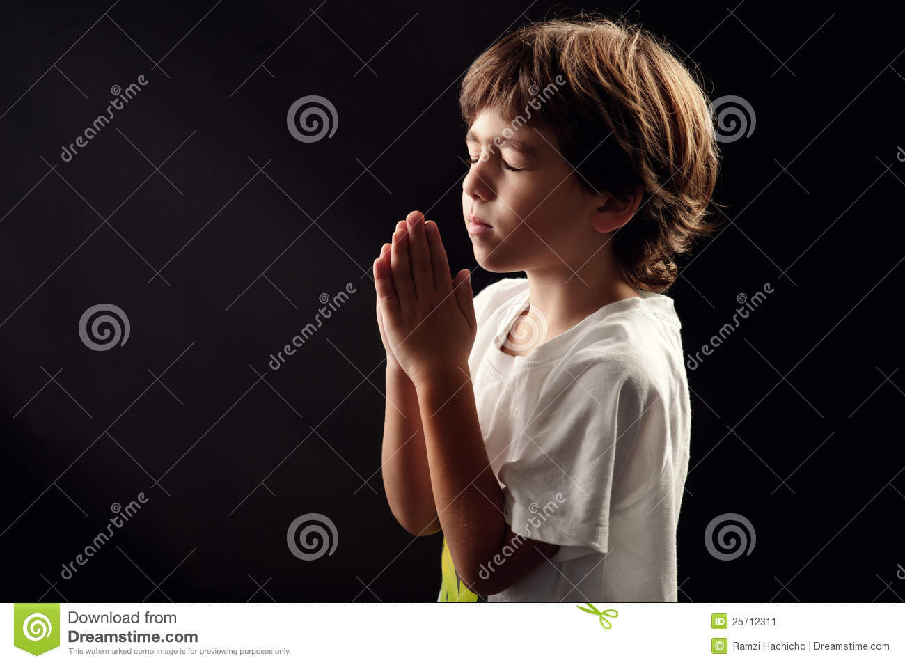 Young kid in a spiritual peaceful moment praying