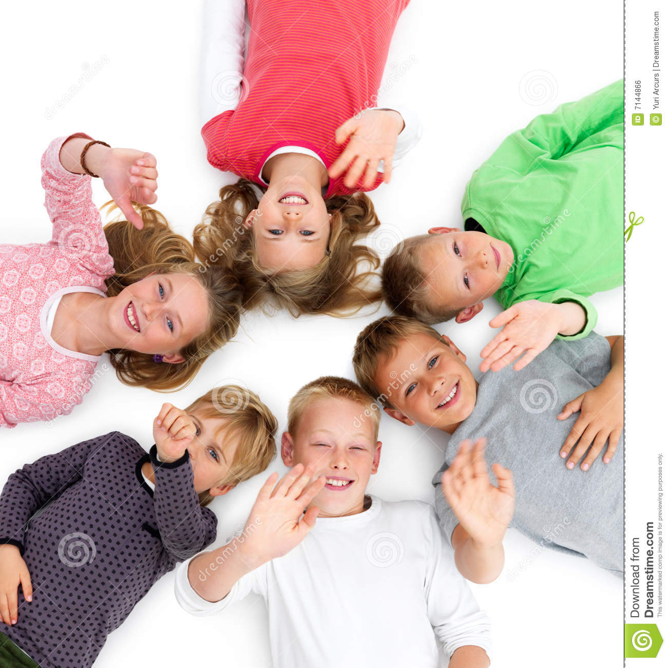 Young Happy Beautiful Family Playing Together On The Beach: Young Kids Lying In A Circle Showing Unity Stock Photo
