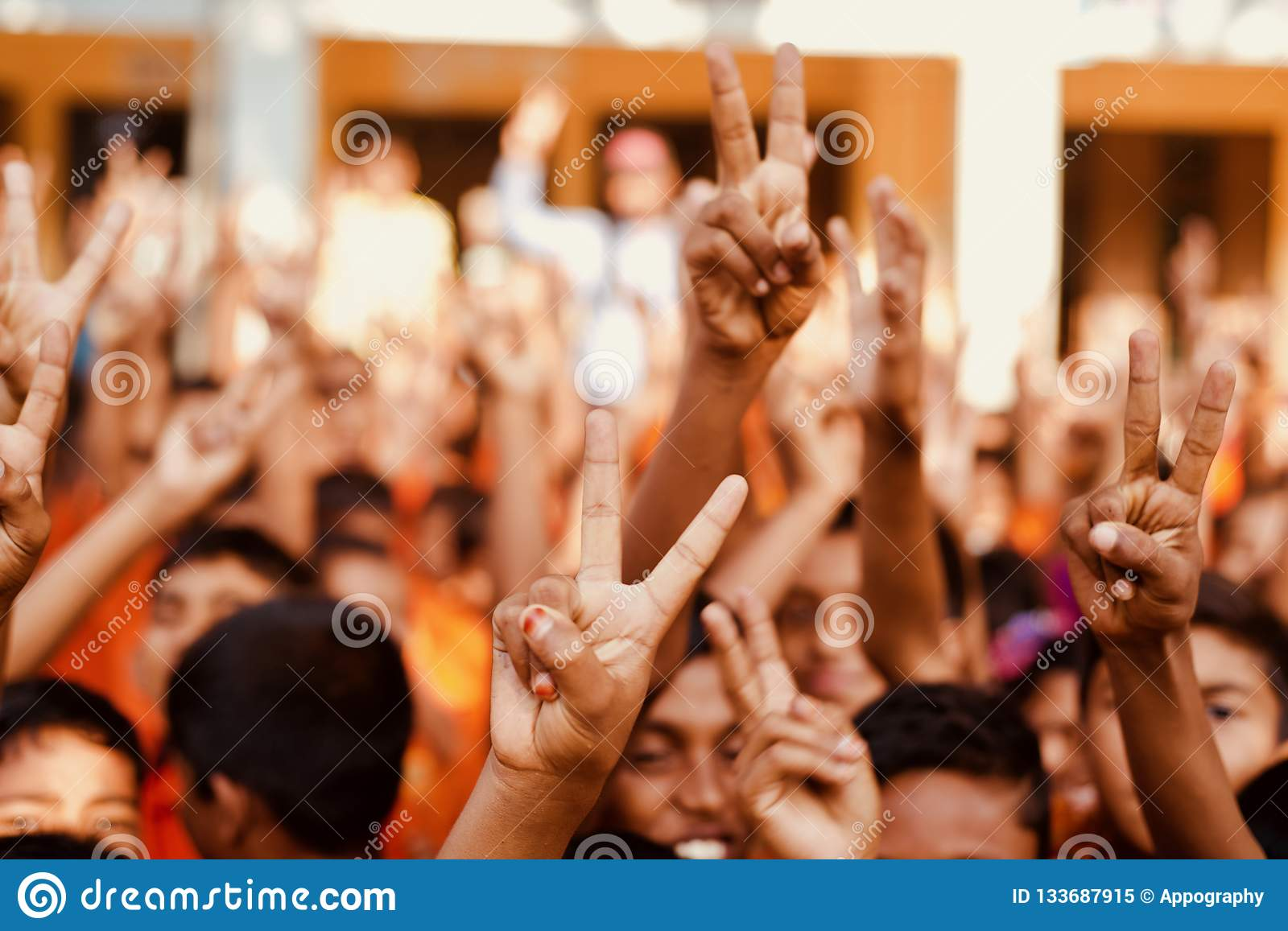 Young kids showing victory sign unique photo