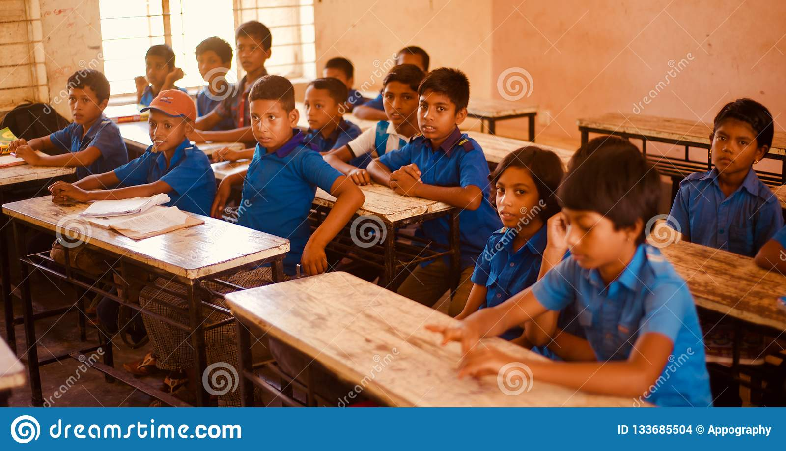 Young kids sitting around a classroom unique photo
