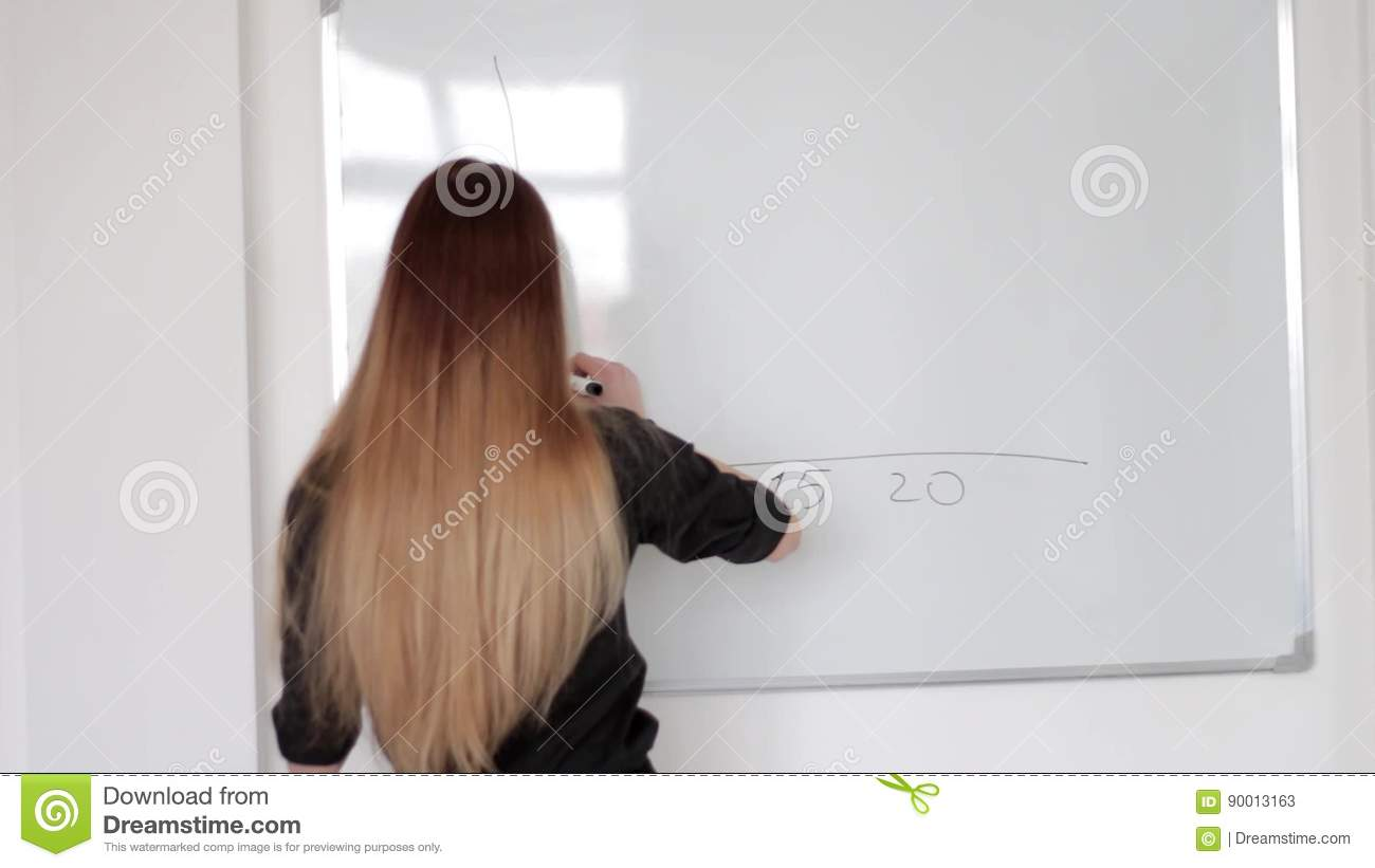 Young Lady With Double Dyed Long Hair Drawing A Graph With Marker On