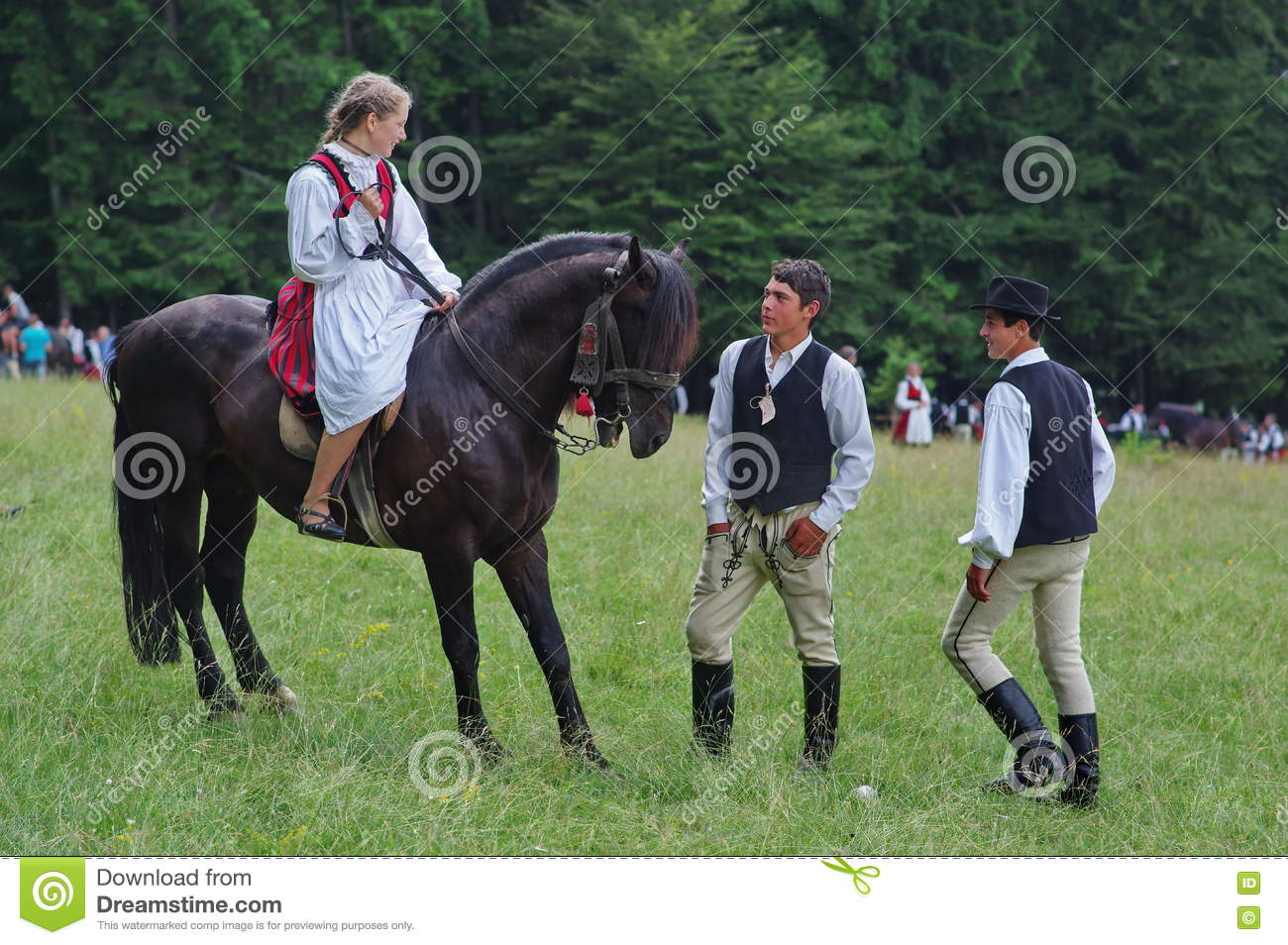 Young lady on horseback and young boys