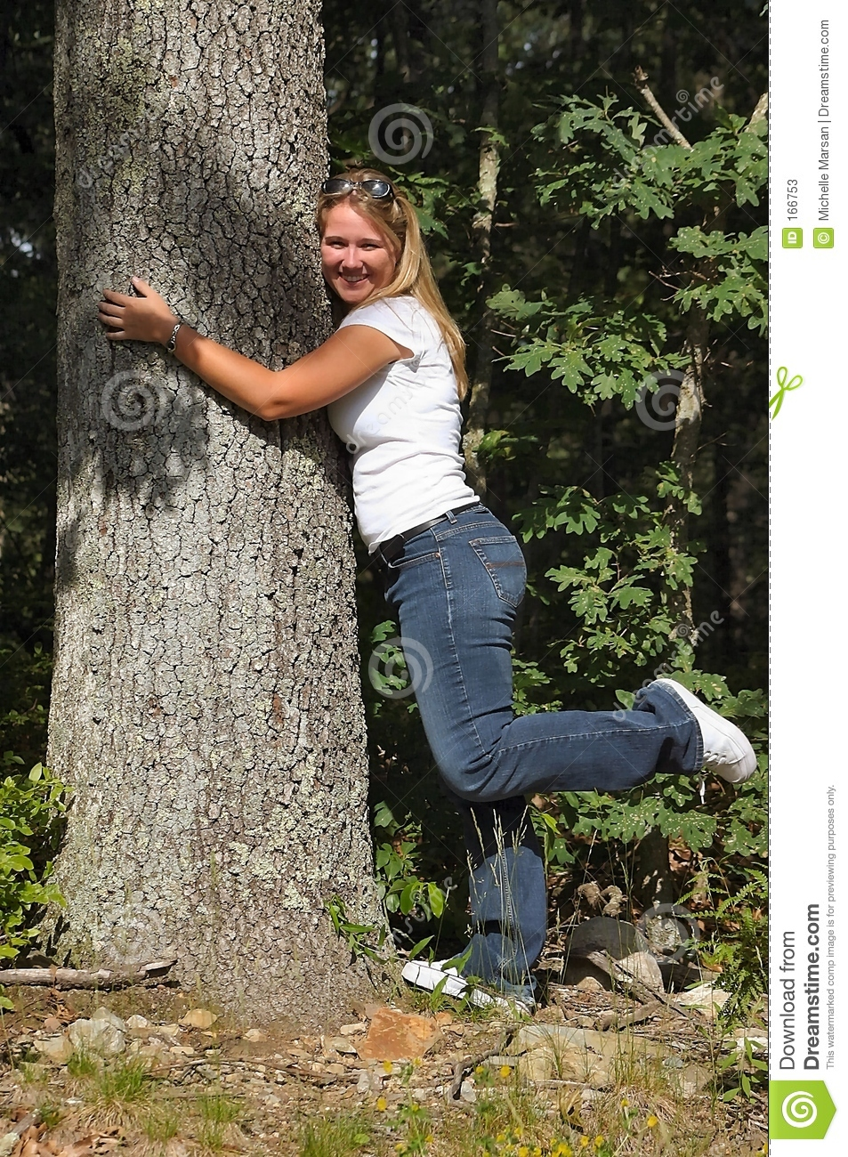 Young lady hugging tree