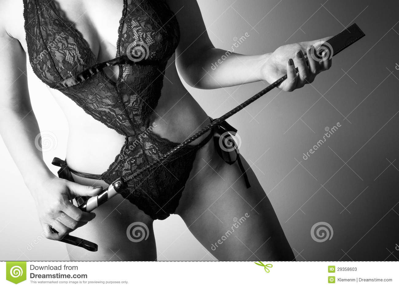 The same Dominatrix leather mistress