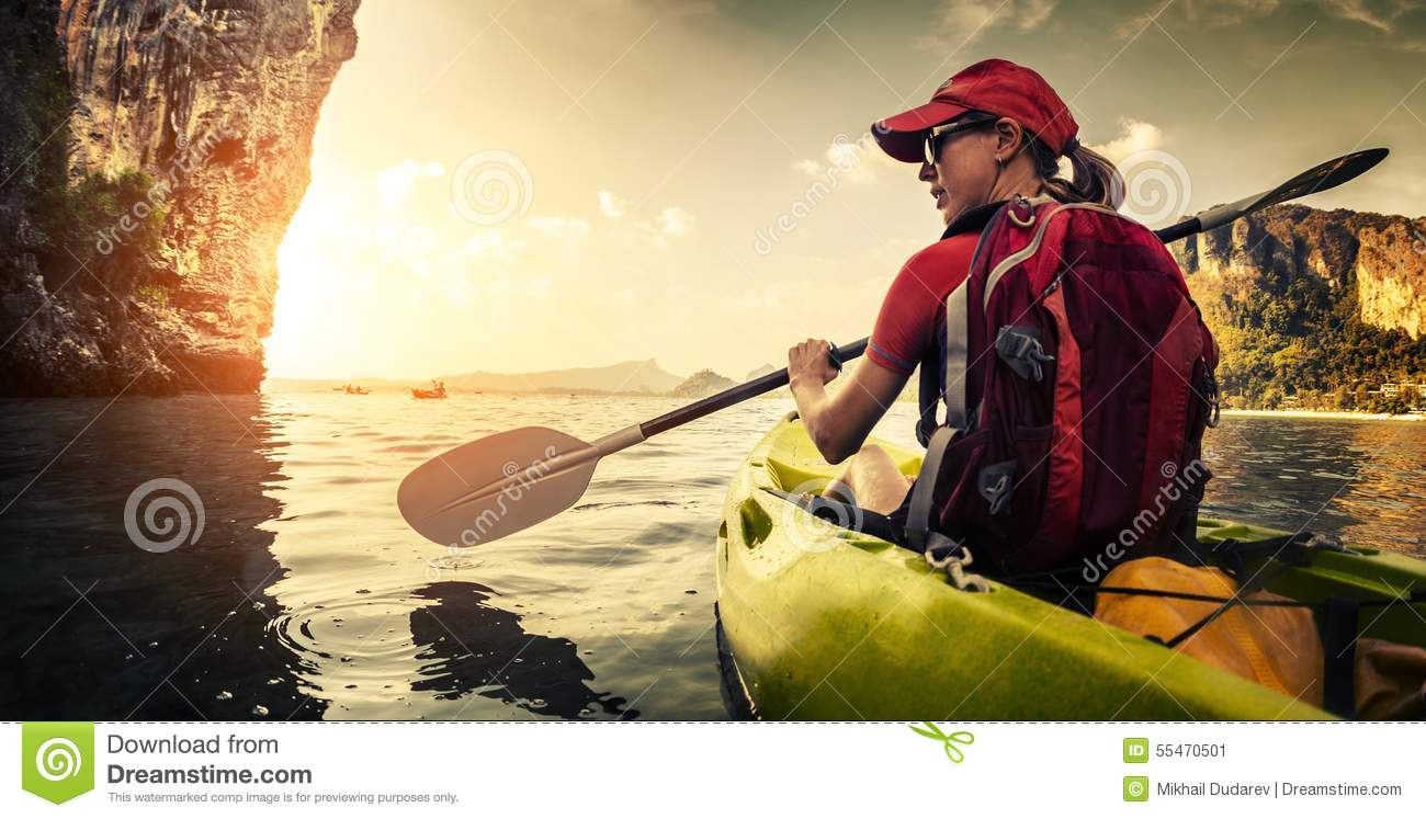 Young lady paddling kayak