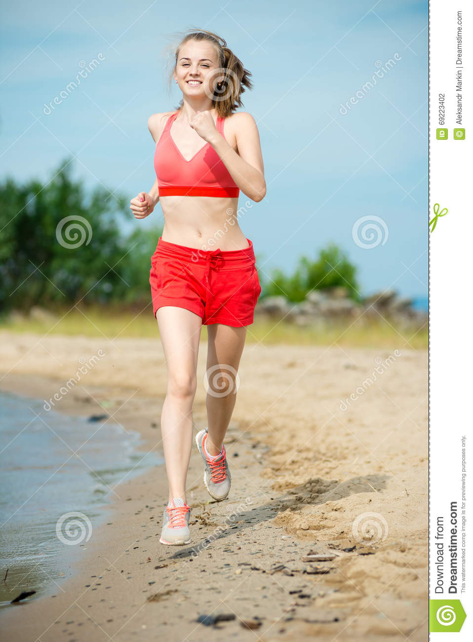 6dfa0ced29870 Young lady running. Woman runner running at the sunny summer sand beach.  Workout near ocean sea coast. Beautiful fit girl. Fitness model caucasian  ethnicity ...