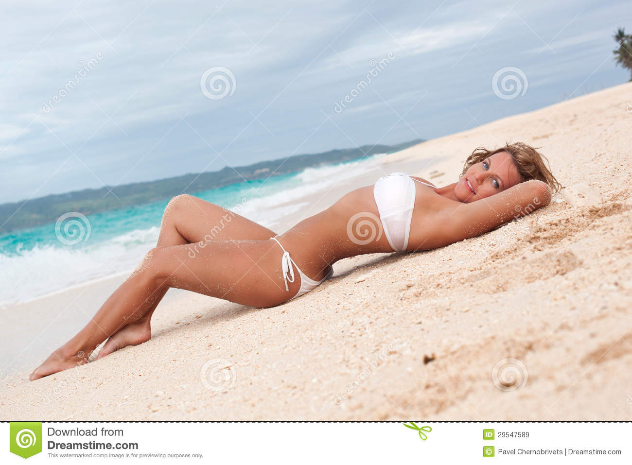 Young lady on tropical beach
