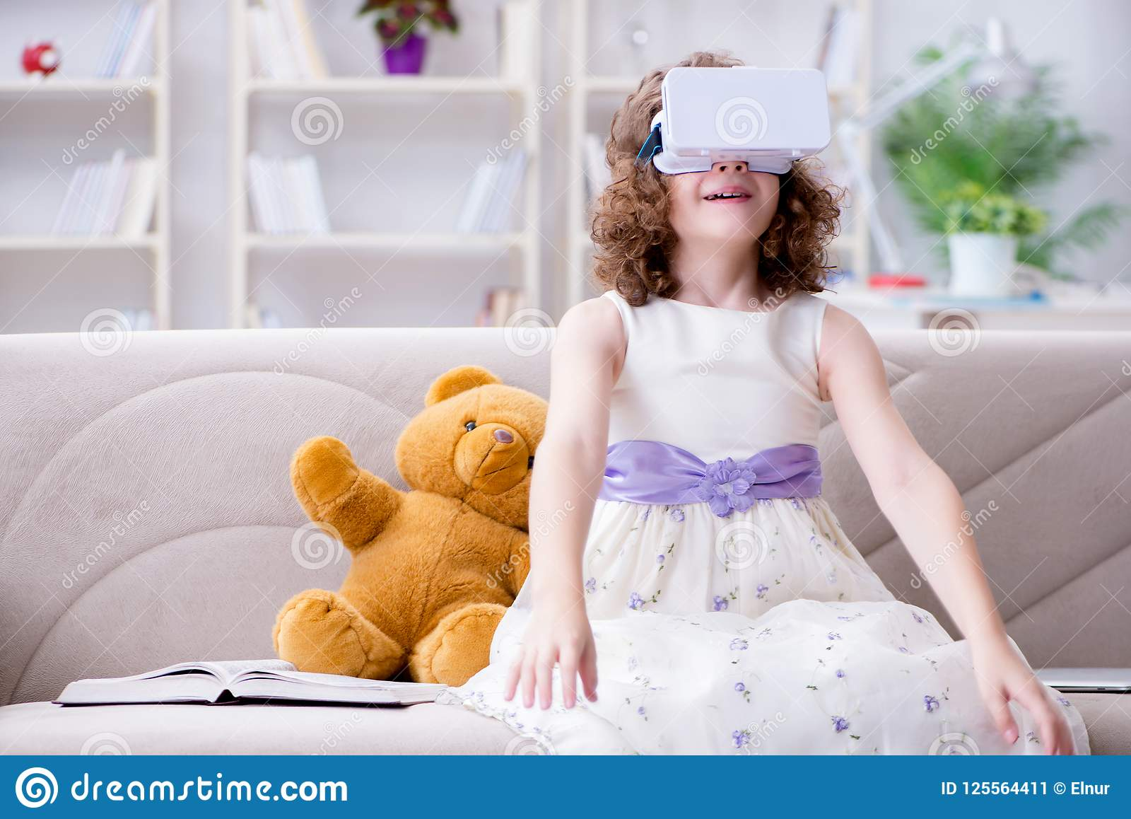 Young Redhead Girl With Virtual Reality Glasses Stock