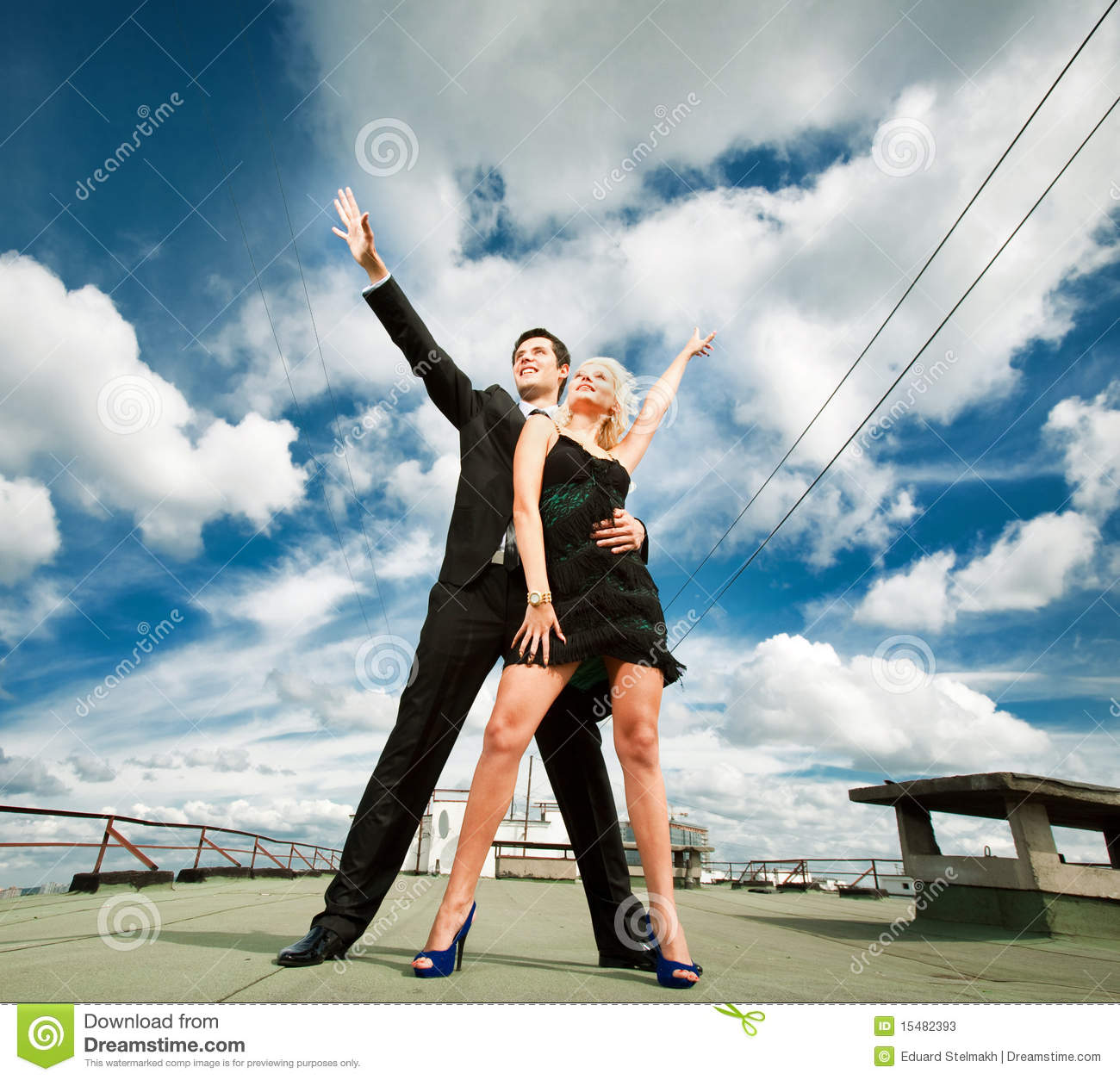 Young Love Couple Smiling Under Sky Stock Image