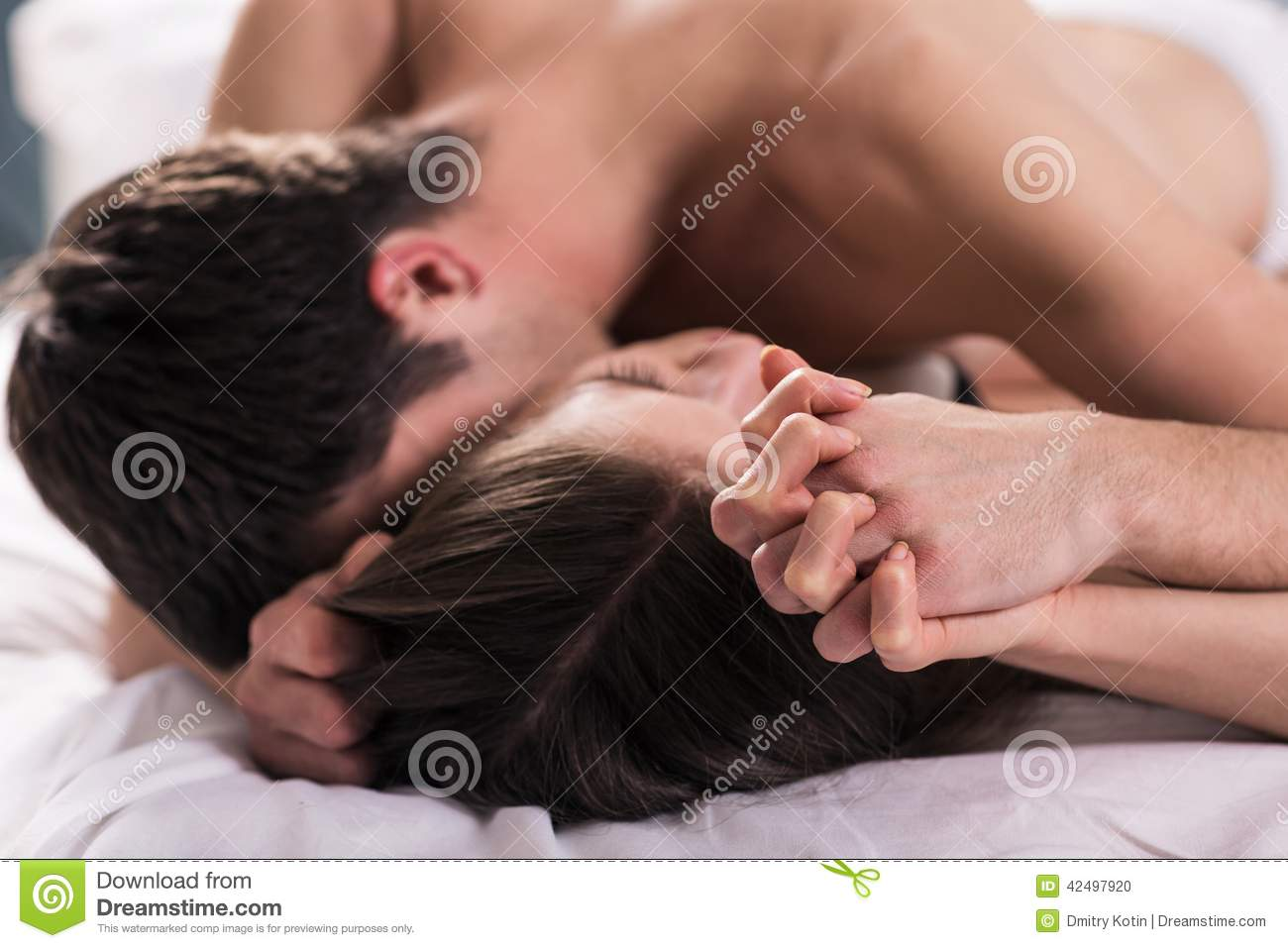 Young lovers kiss stock photo  Image of couch, attractive