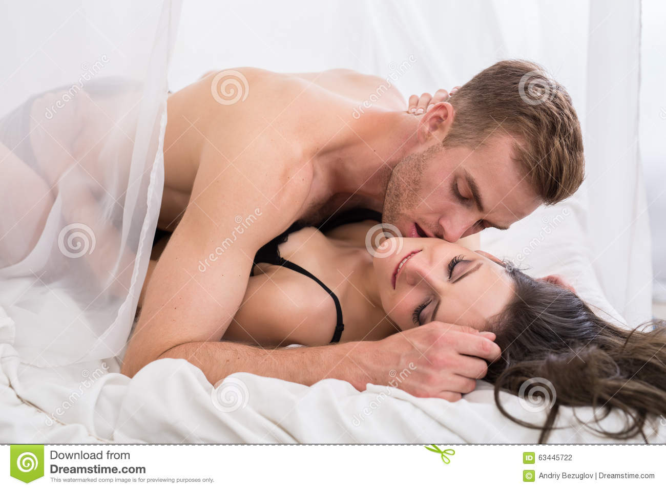 Young Lovers Lie In The Bed Stock Photo