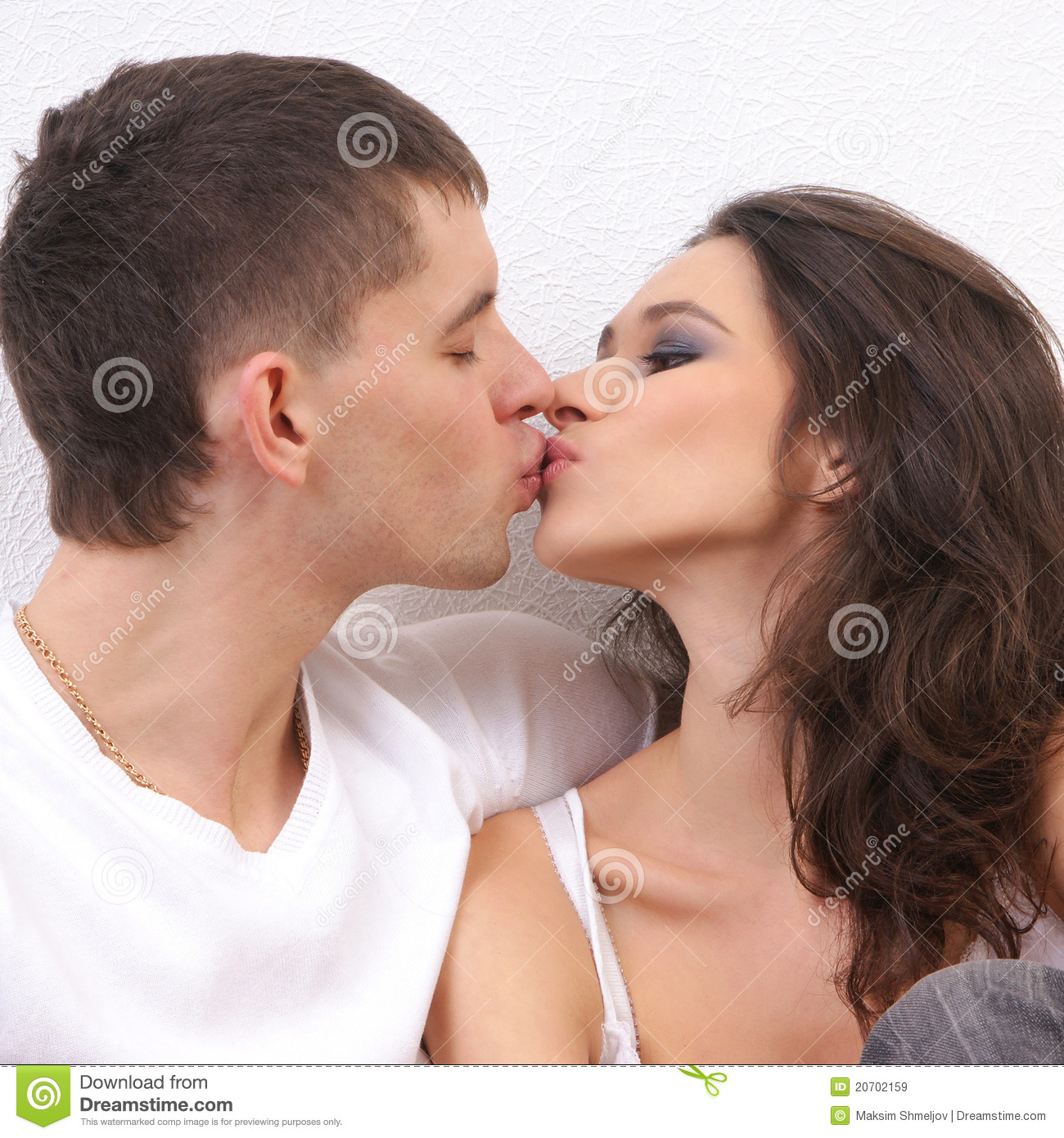 A Young And Loving Couple Kissing Each Other Stock Image