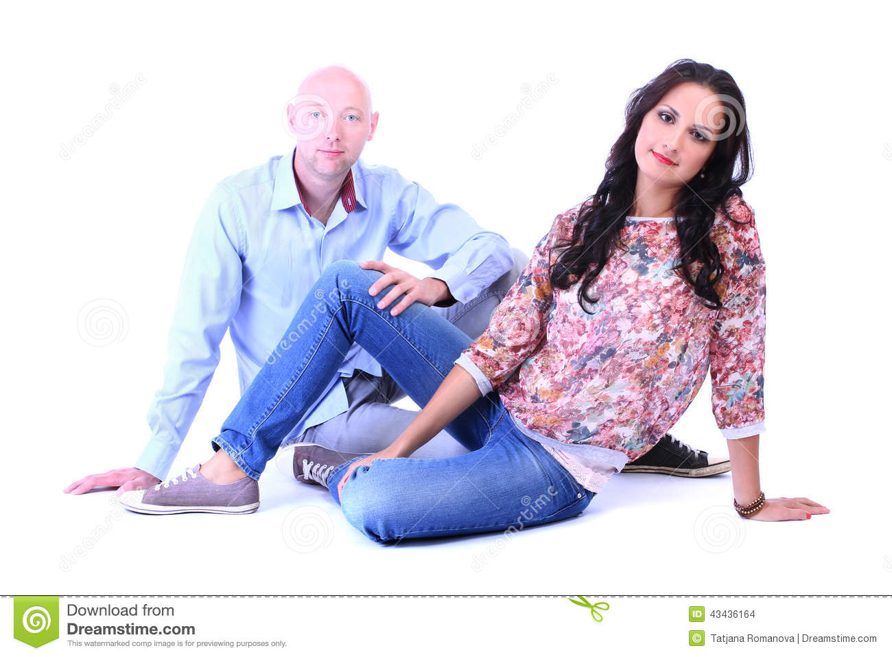 Young loving couple sitting on floor