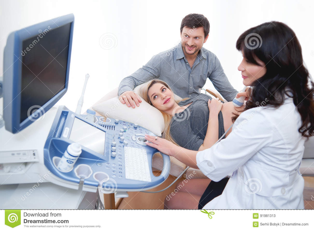 Young Loving Pregnant Couple Visiting Doctor Together Stock Image - Image  of mother, image: 91981313