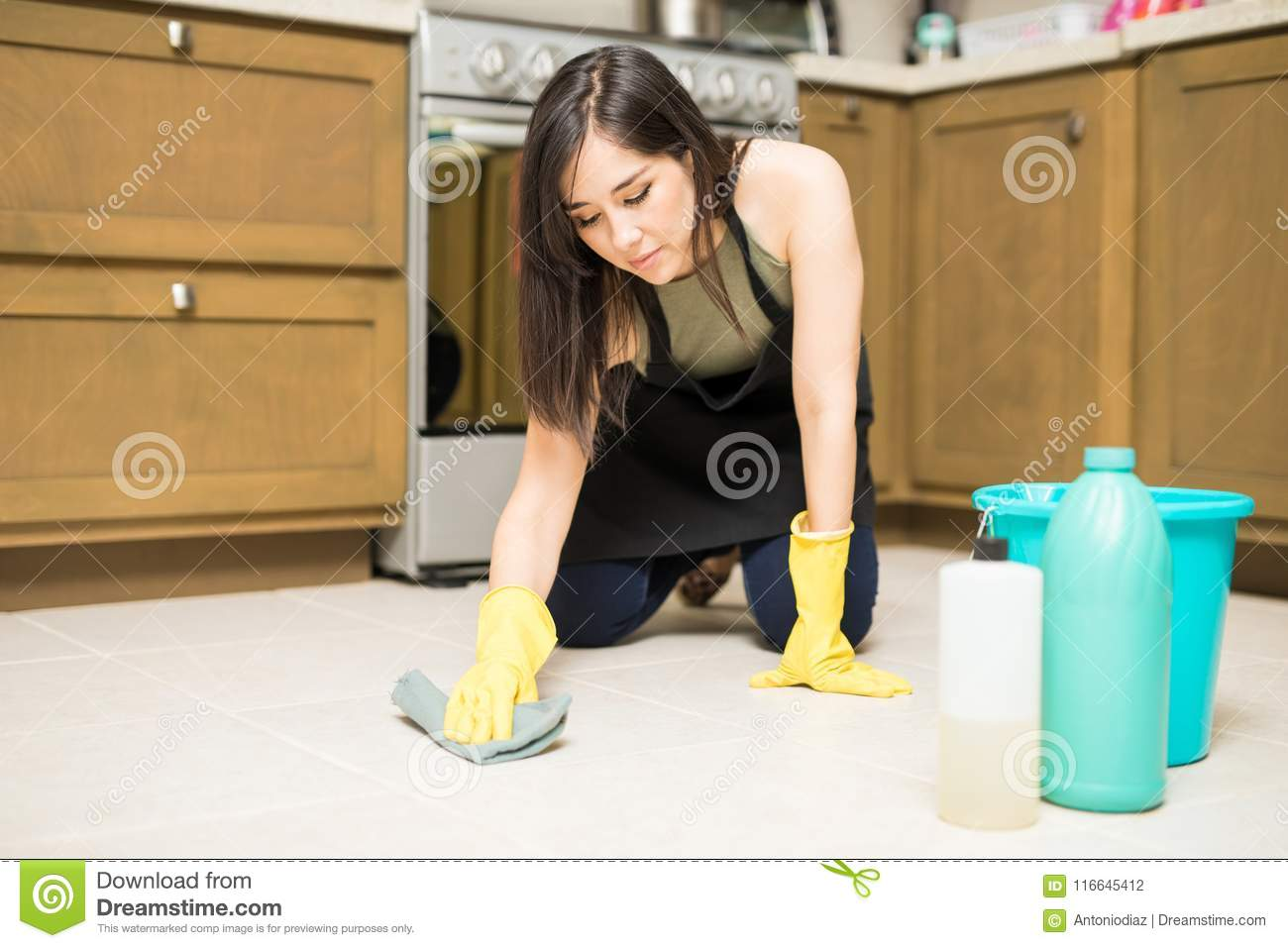 Young Maid Washing Floor In Kitchen Stock Photo Image Of