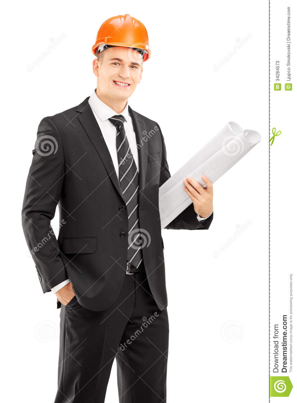young male architect in black suit wearing helmet and