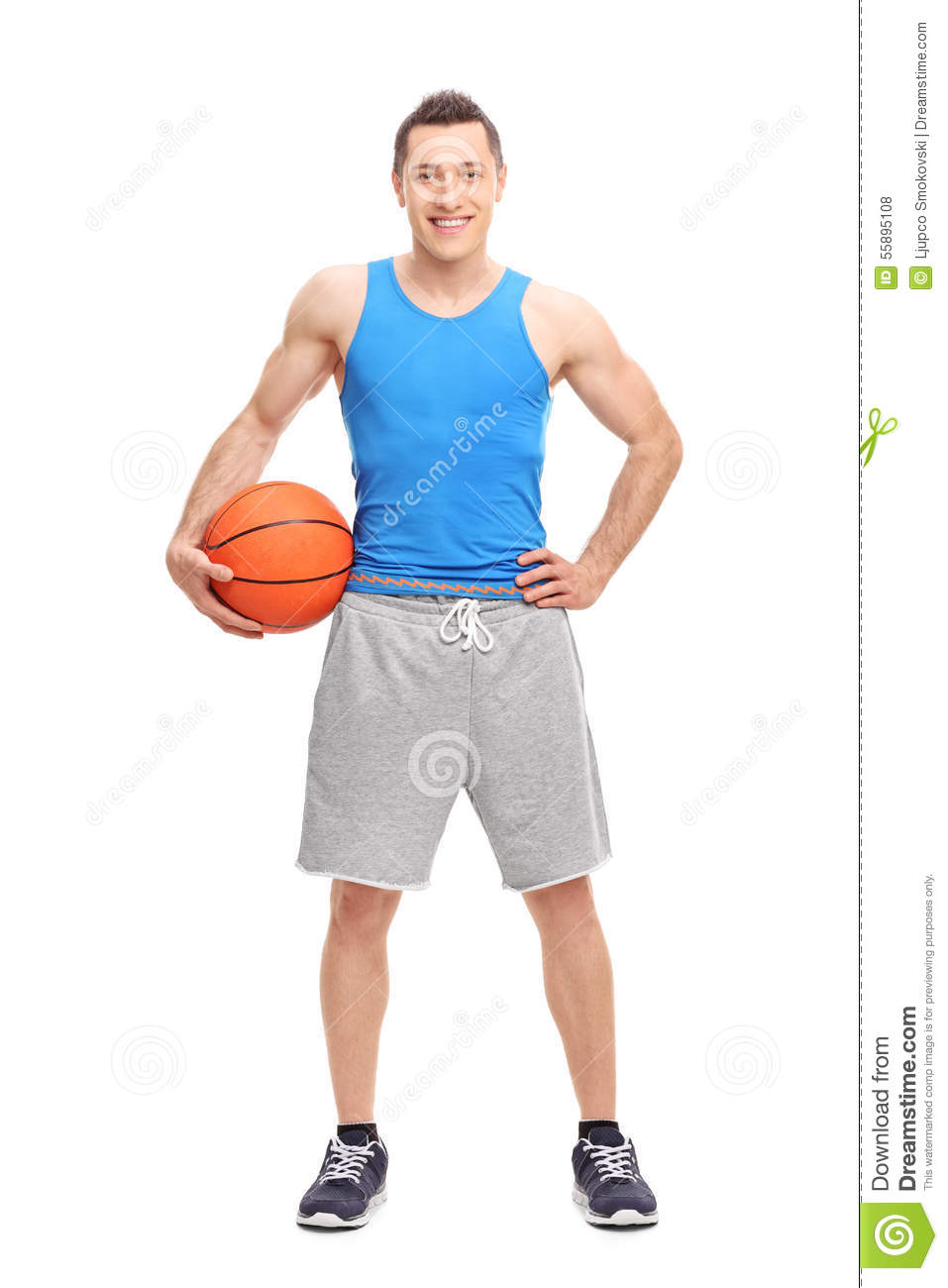 young male athlete holding a basketball stock photo image of