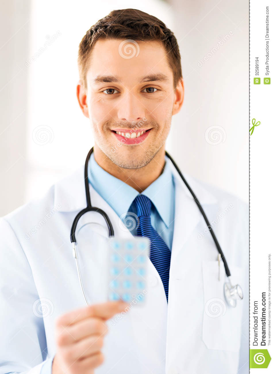 Young Male Doctor With Pack Of Pills Stock Images - Image: 32589194