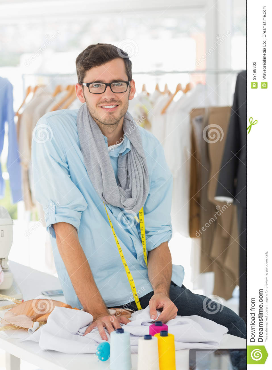 Young male fashion designer at work stock photo image Contemporary fashion designers