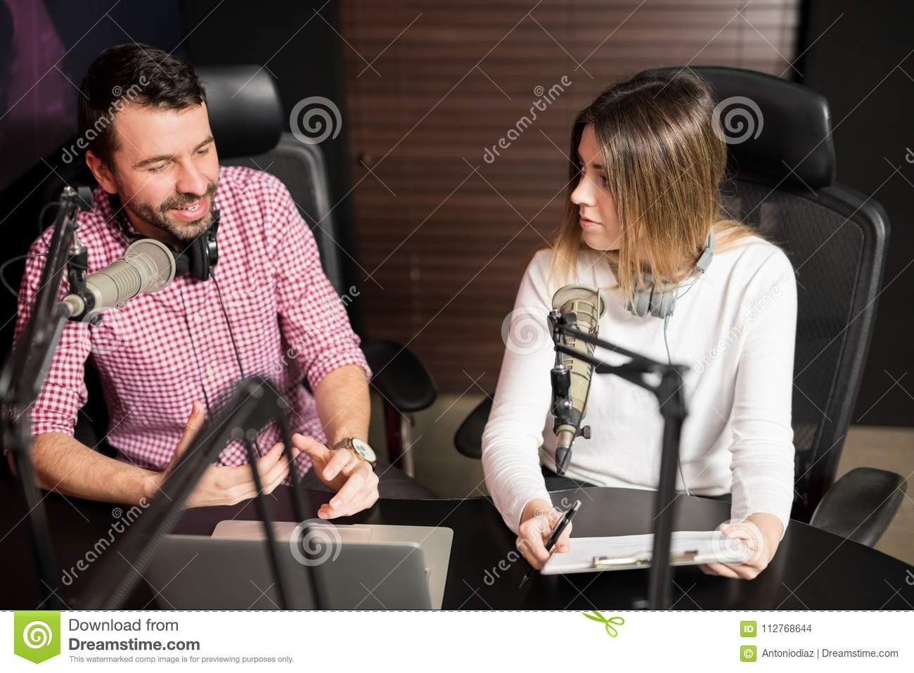 Presenters Hosting Show For Radio Live In Studio Stock Photo - Image