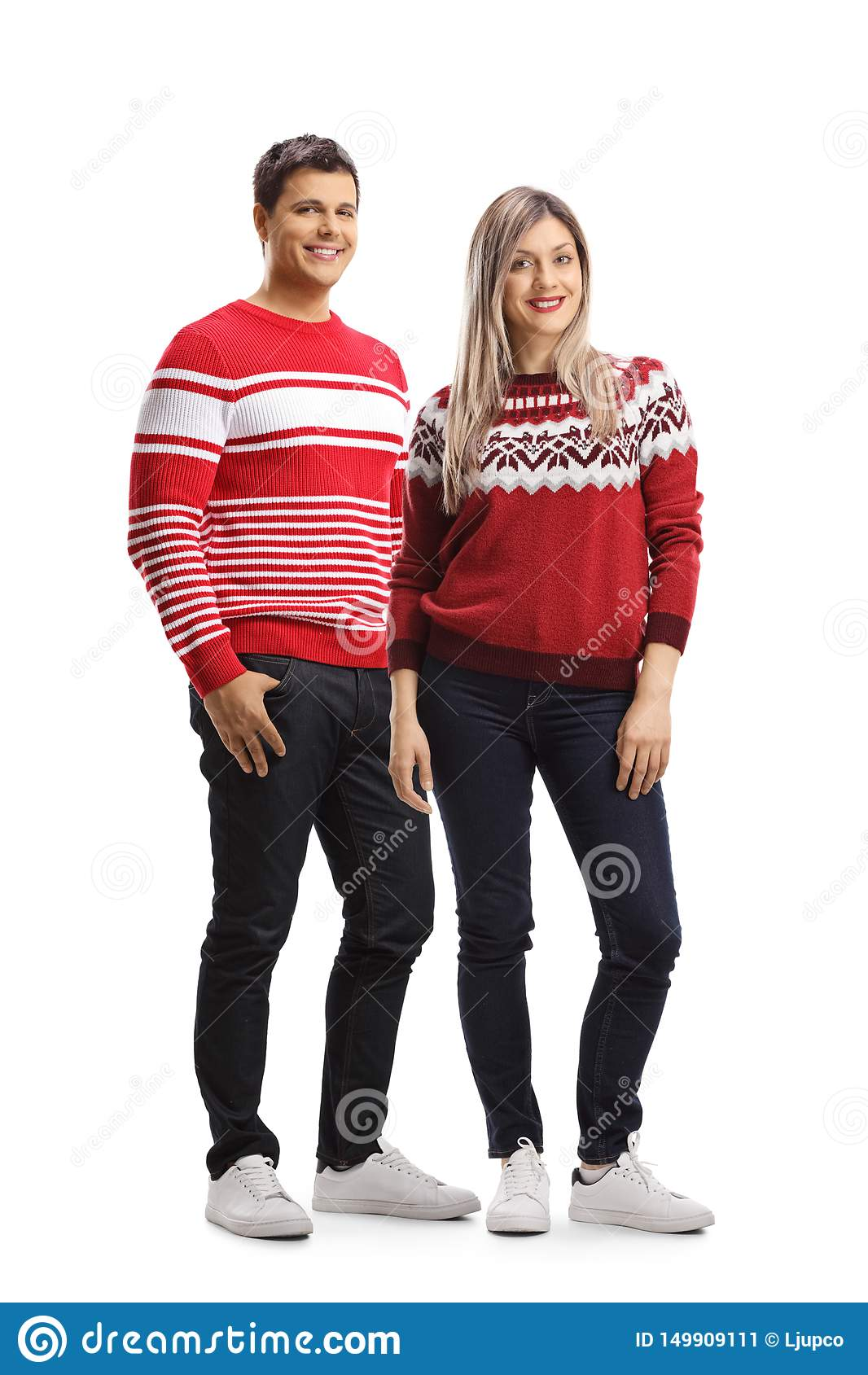 Young male and female wearing christmas red sweaters and posing