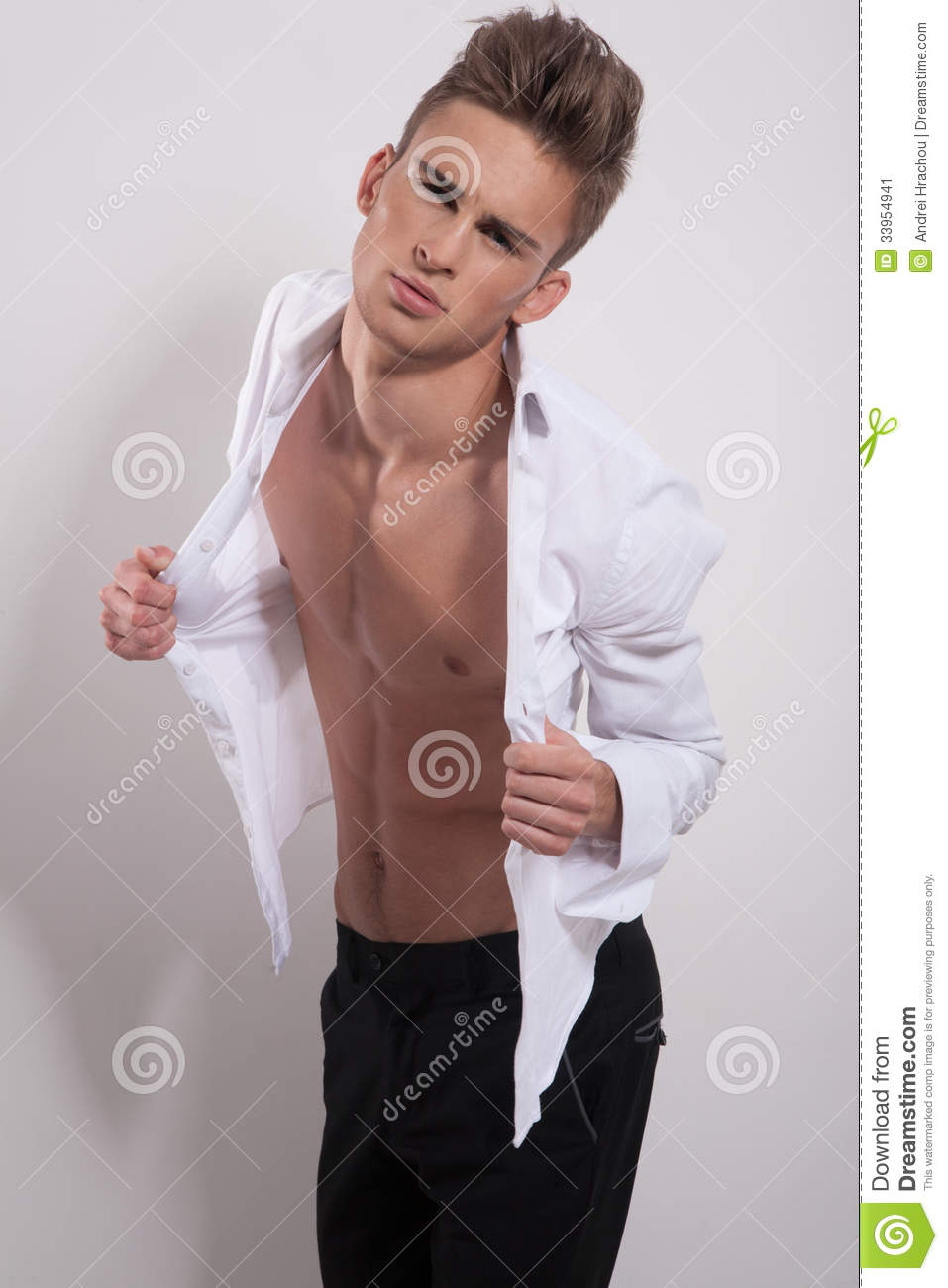Young Male With Hands On His Shirt Stock Image Image