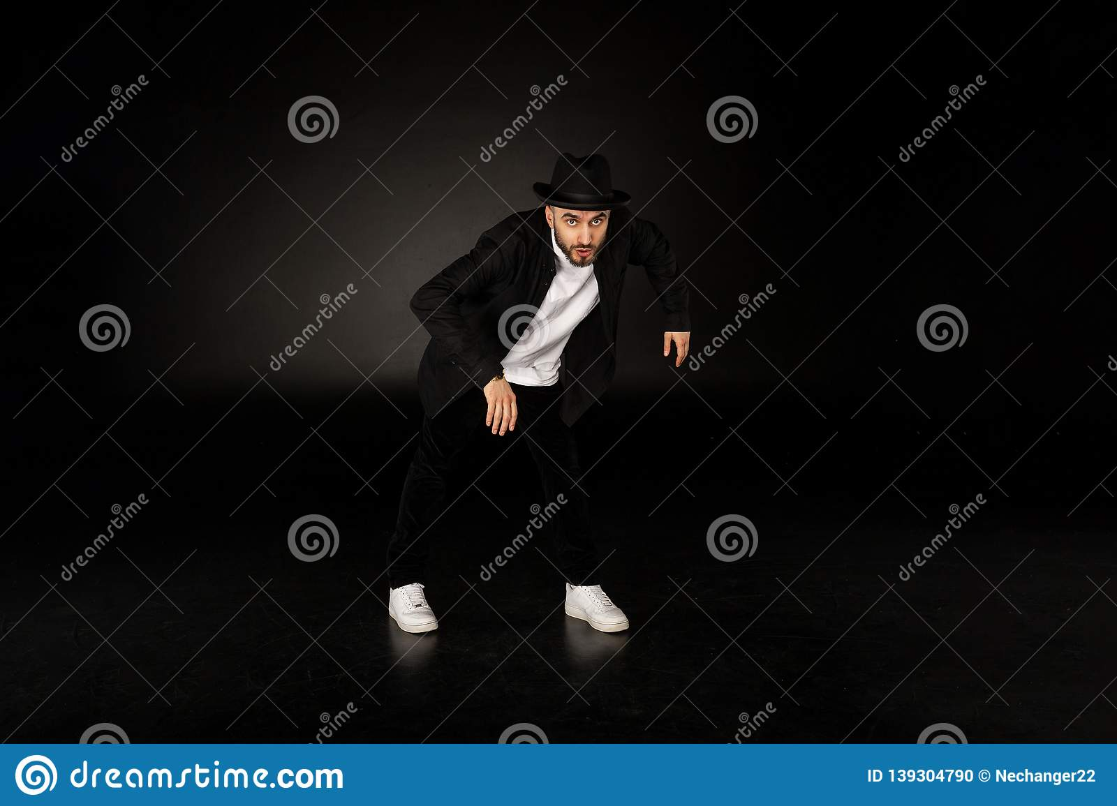 57eeab2ad Young Male Modern Dancer In Black Clothes And Hat Stock Photo ...