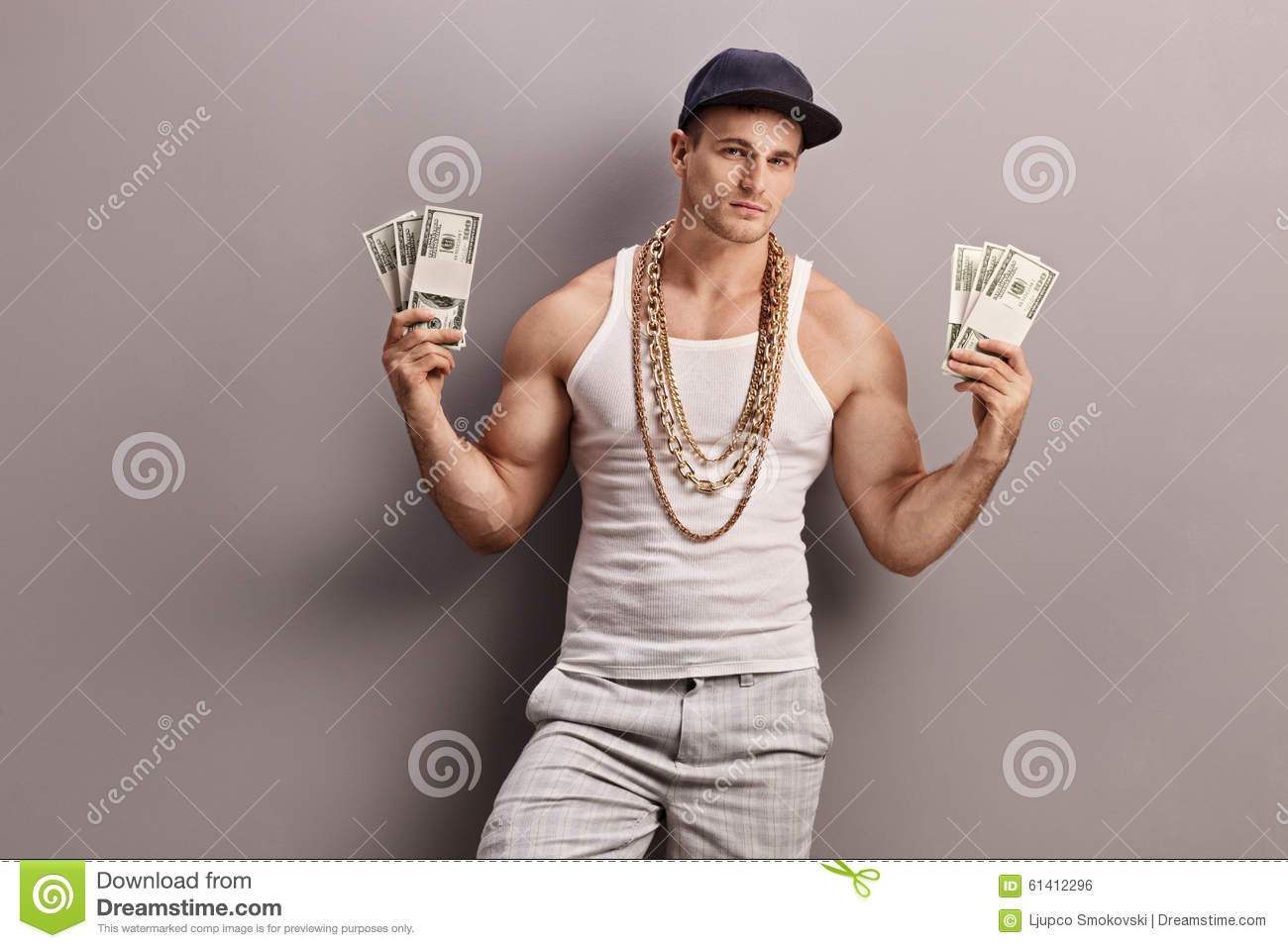 Young male rapper holding money