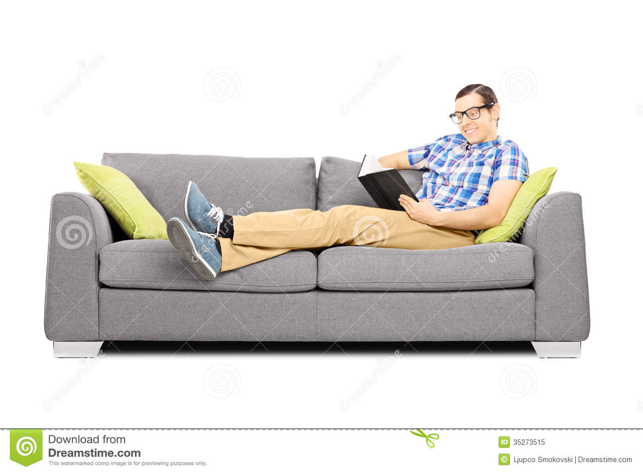 Reading Sofas : Young Male On A Sofa Reading A Book Royalty Free Stock Photo - Image ...