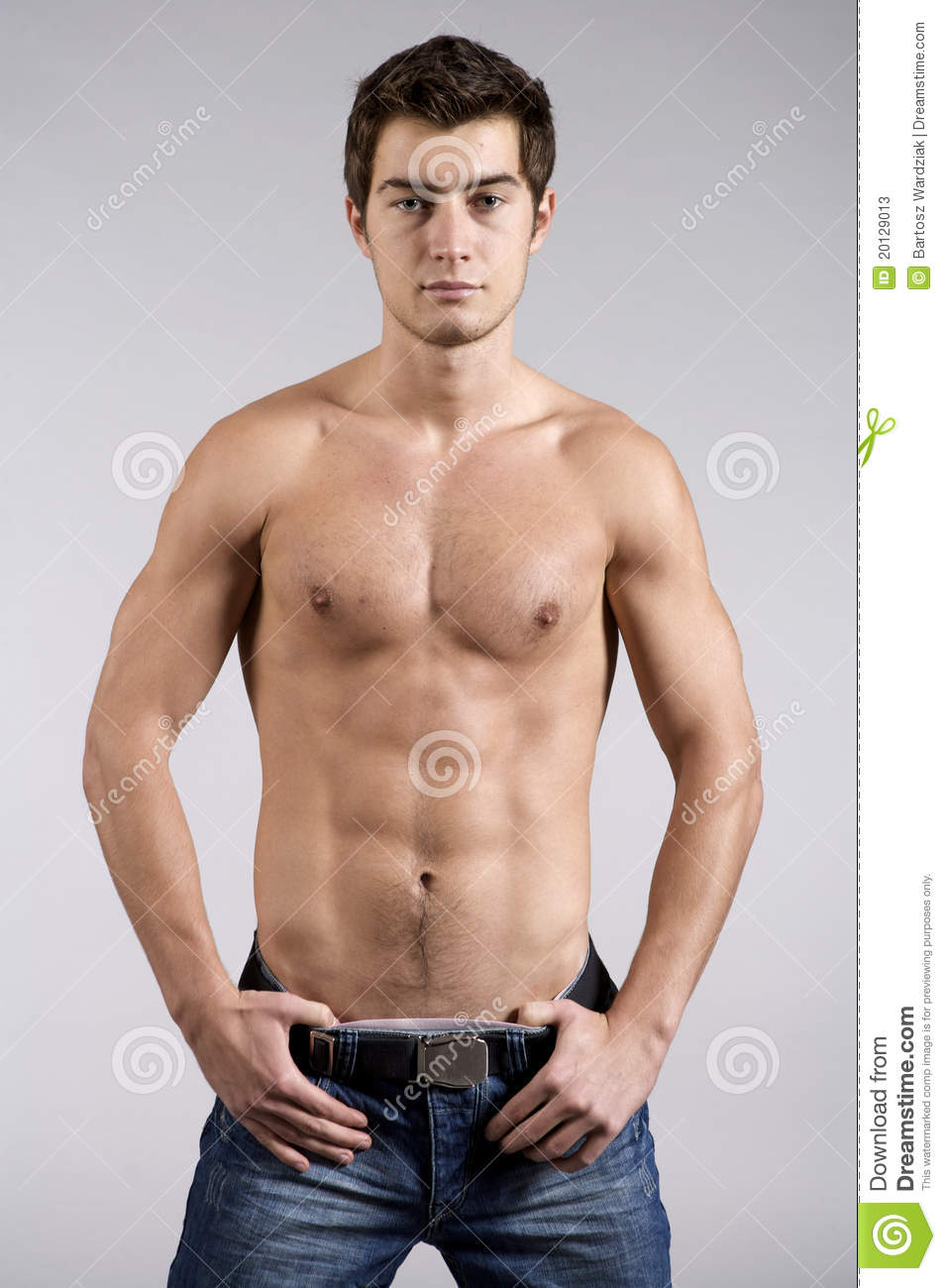 Young male underwear model on grey background.