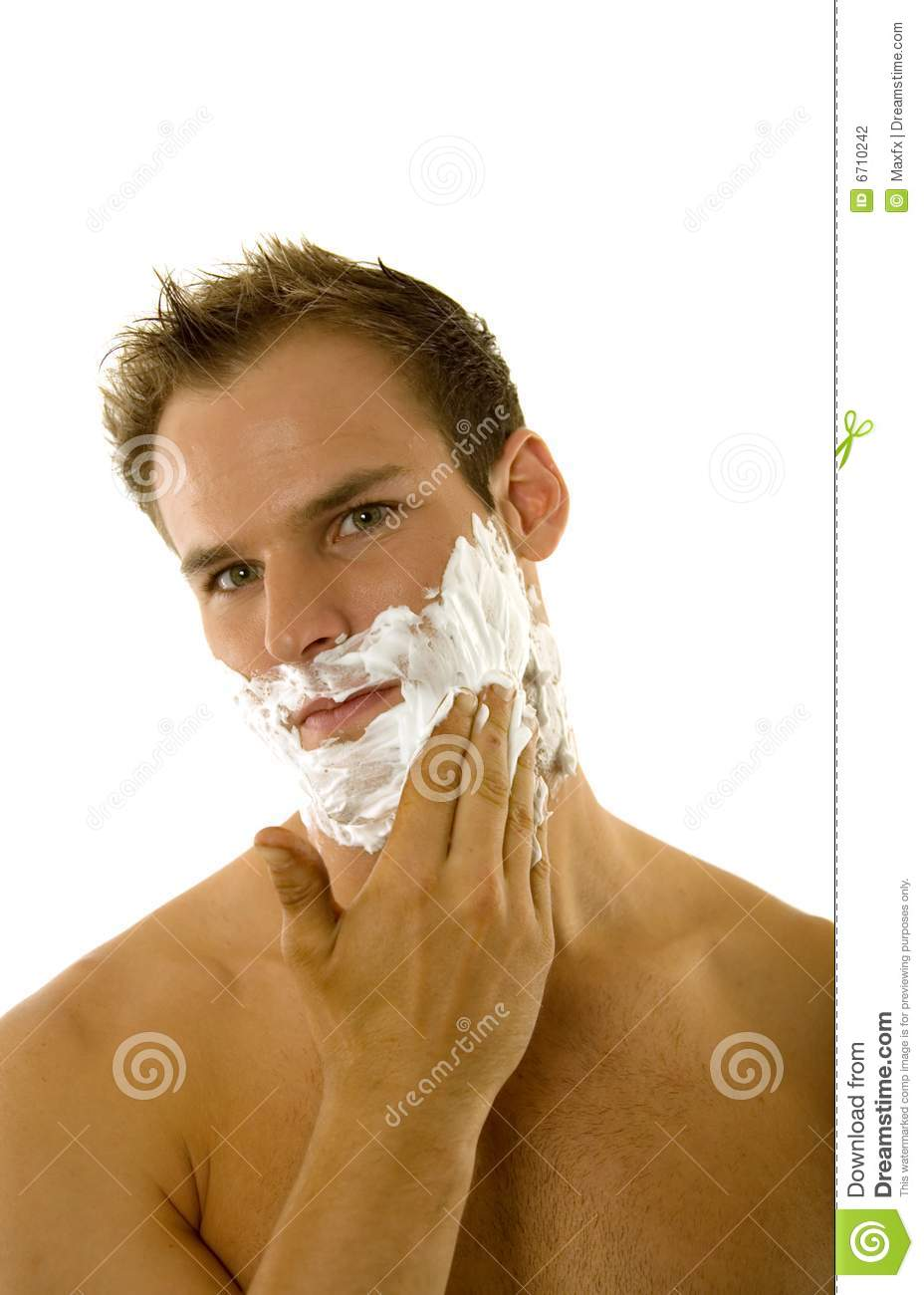 Young Man Applying Shaving Cream To His Face Stock Photo