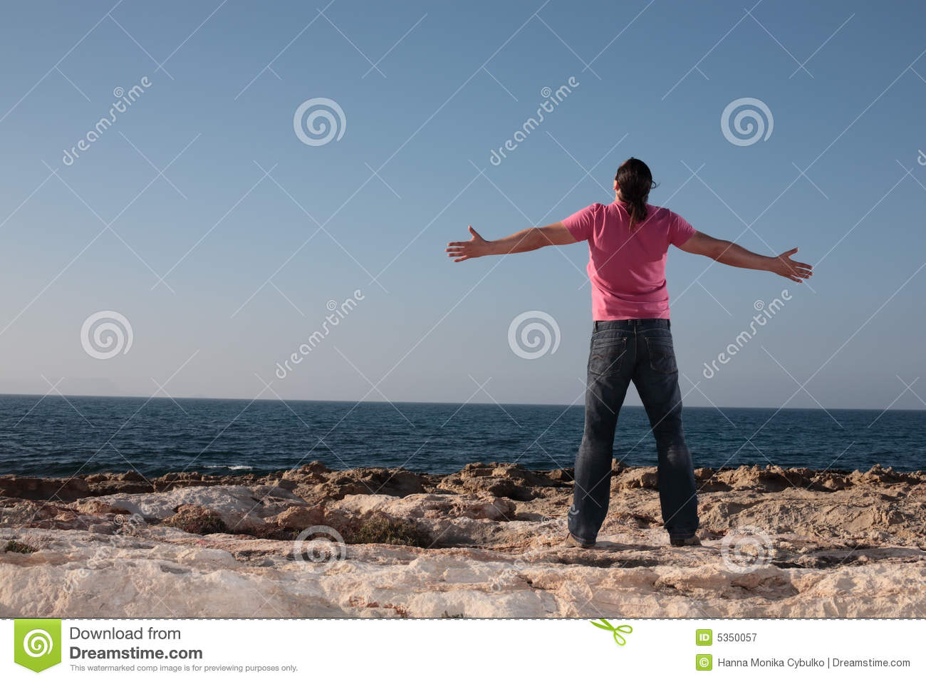 Young man with arms outstretch