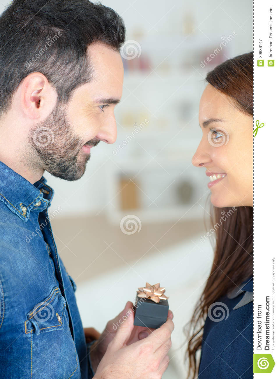 Young man asking beautiful girl for hand