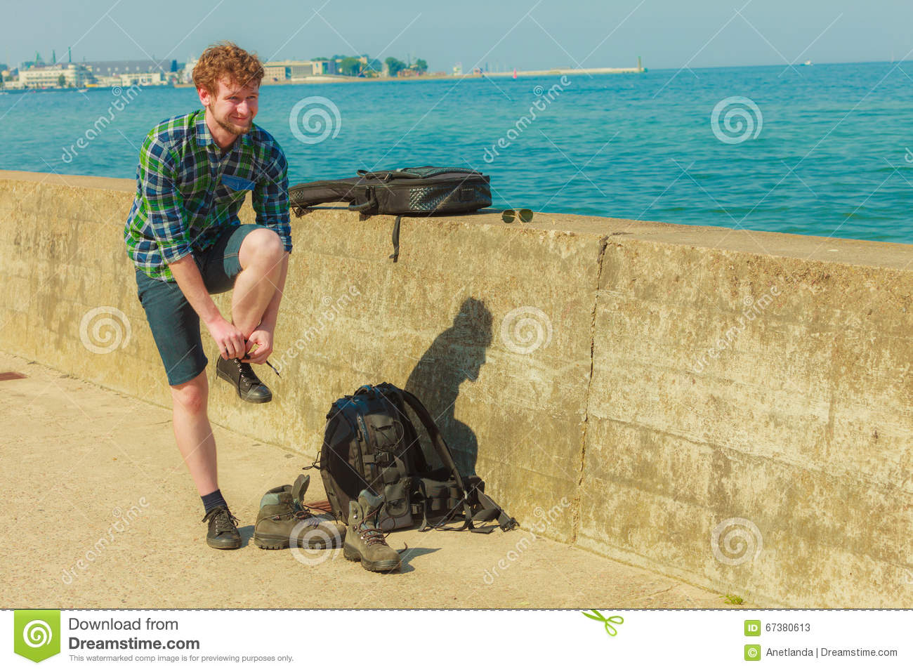 Young Man With Backpack Hikiner On Sea Coast Stock Image - Image of ... a5776ac552d28