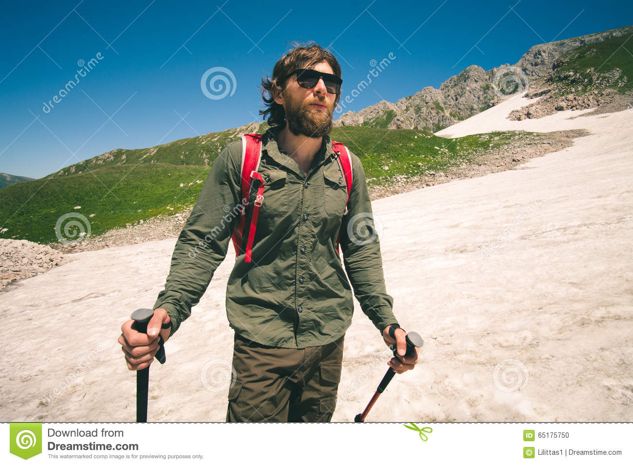 Young Man with backpack hiking outdoor Travel Lifestyle concept