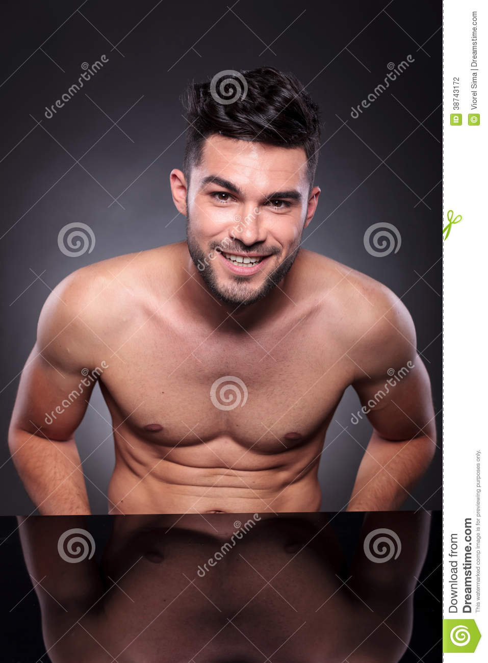 Young Man With Bare Chest Smiles At You Stock Photography