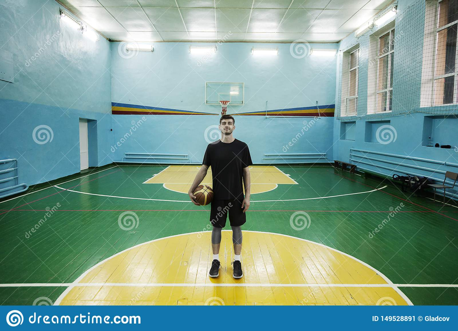 Basketball player in action in a basketball court