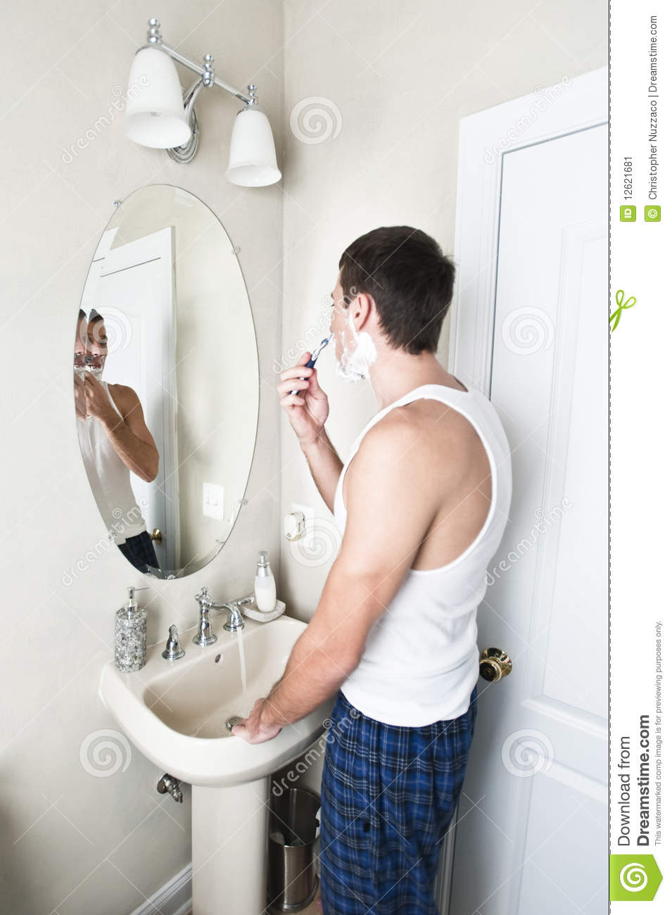 Young Man In Bathroom Shaving Stock Image Image 12621681