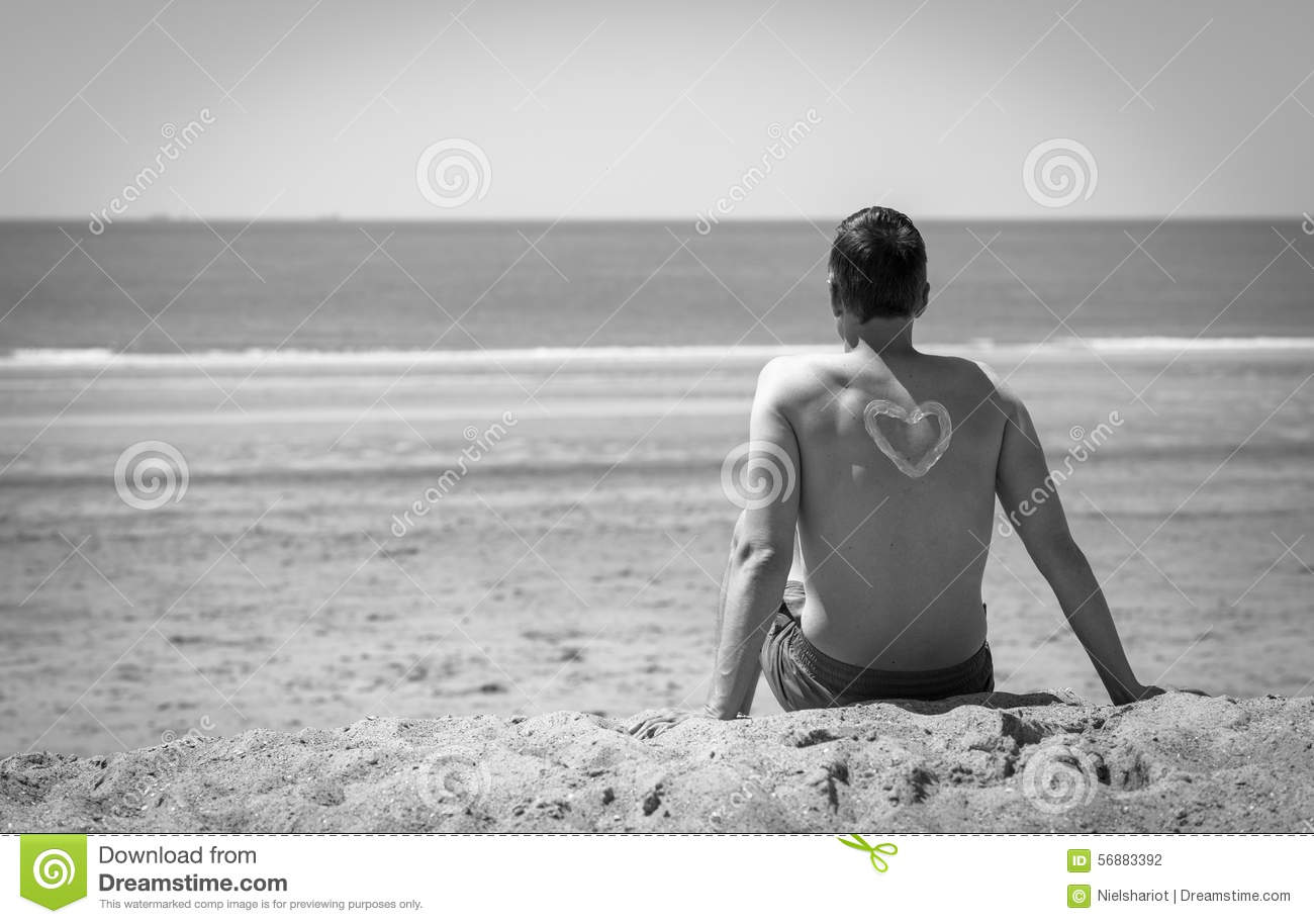 Young man on the beach in black and white