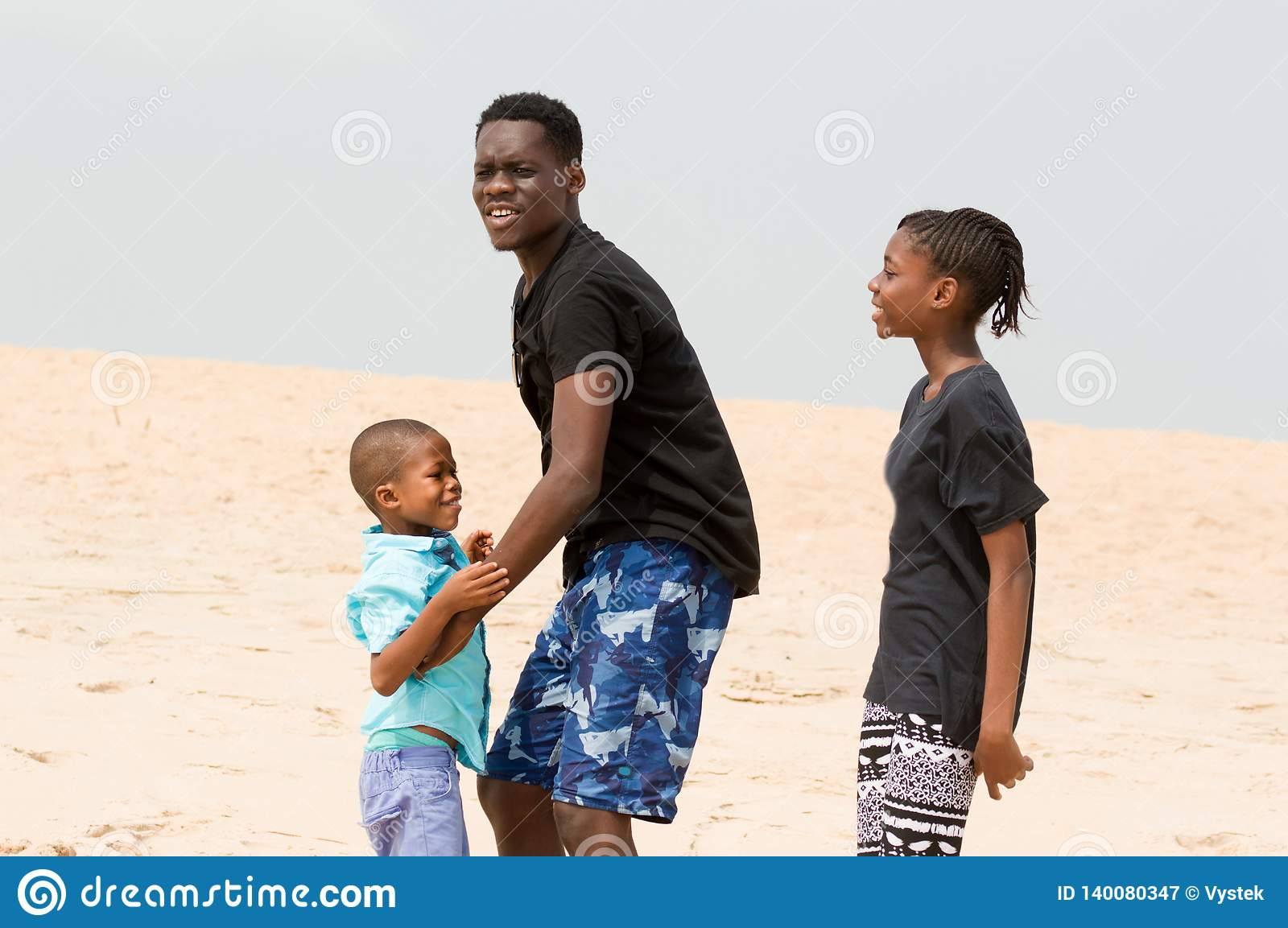 Young Man At The Beach With His Family Stock Image Image Of Parent American 140080347