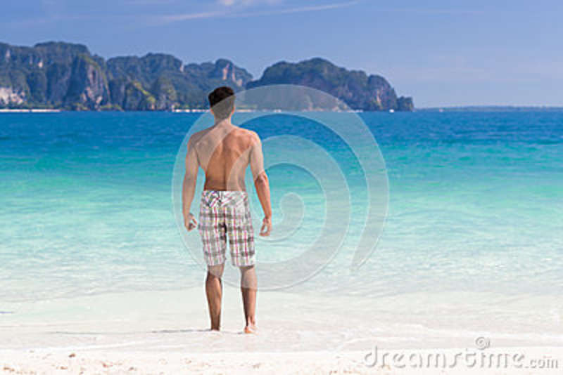 Young Man On Beach Summer Vacation, Guy Standing Back Seaside Blue Water