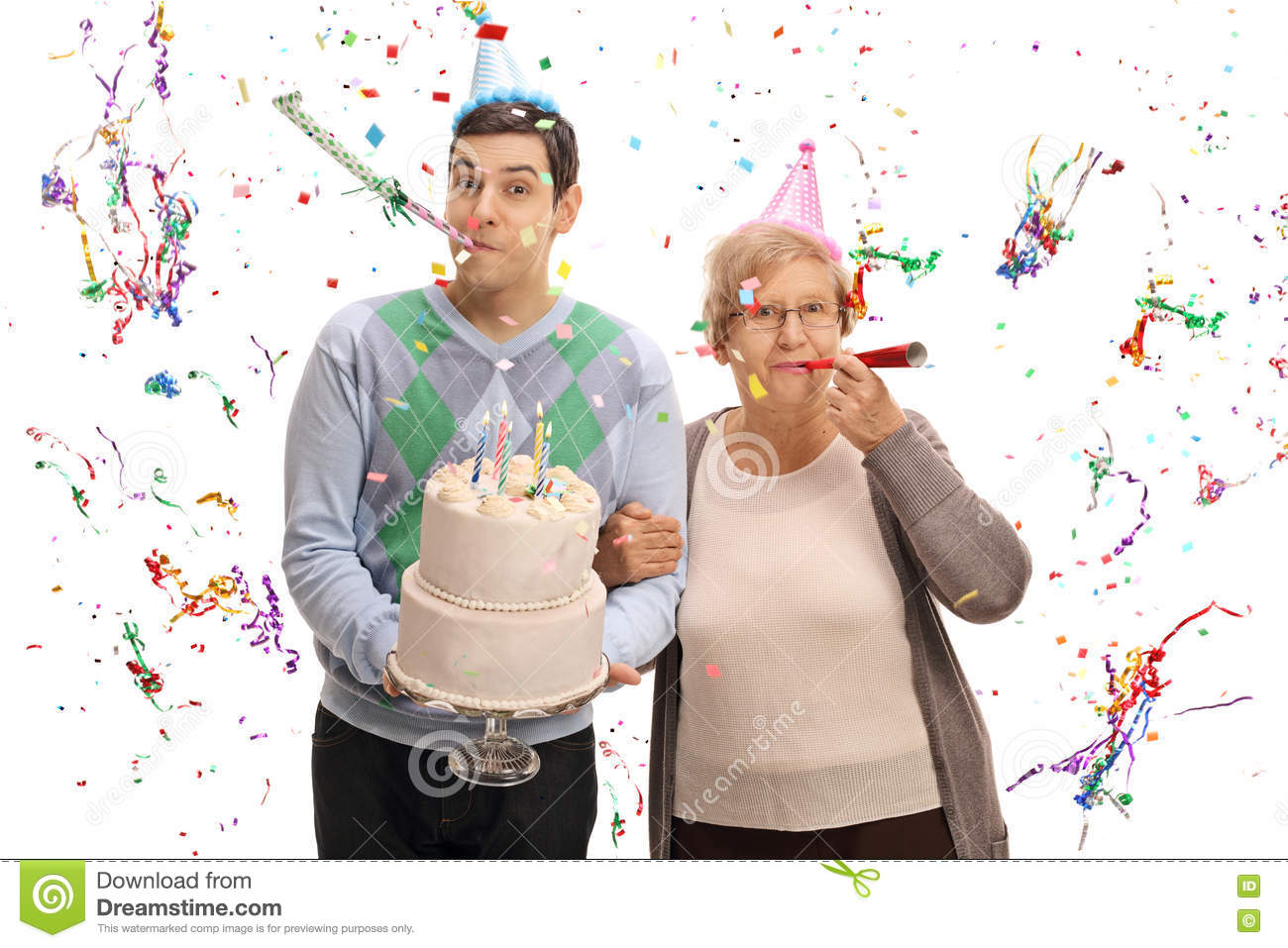 Young man with birthday cake and mature woman blowing party horn